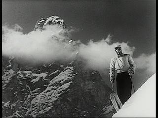 """Luis Trenker am Langkofel: Szene aus dem Film """"Im Banne des Monte Miracolo"""" von 1949, Foto: Movieman Productions"""
